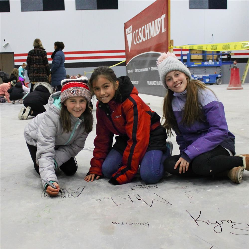 MAKING THEIR MARK - SIGNING THE NEW HORIZON GYMNASIUM FLOOR